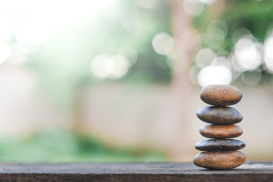 Balance stone with spa on abstract bokeh nature background