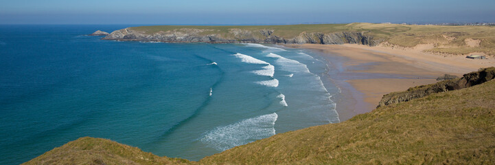 Fototapete - Holywell Bay beach North Cornwall with waves and blue sea panoramic view