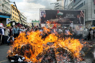 Iranians march during a protest marking the annual al-Quds Day (Jerusalem Day) on the last Friday of the holy month of Ramadan in Tehran