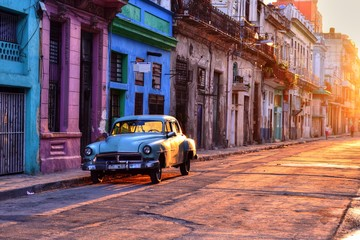 Spoed Fotobehang Havana Old blue car parked at the street in Havana Vieja, Cuba