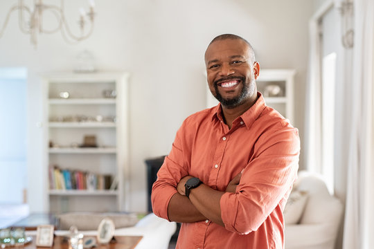 Mature black man with crossed arms looking at camera