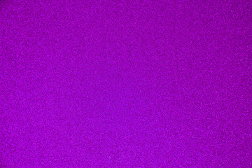 An abstract purple background made of twinkling glitter that is great for a background for Christmas and other celebrations.