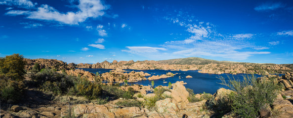 Wall Murals Arizona Panorama of the rugged beauty of Watson Lake in Prescott Arizona. This reservoir is surrounded be weathered cliffs of the Granite Dells and blear blue skies.