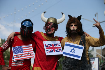 Iranians wear masks during a protest to mark the annual al-Quds Day (Jerusalem Day) on the last Friday of the holy month of Ramadan in Tehran