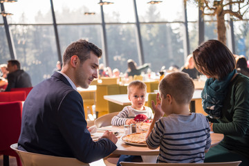 happy family enjoying lunch time together