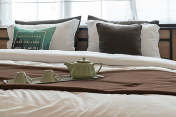 tray of coffee cup on modern bed