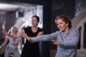 sporty women doing aerobics exercises
