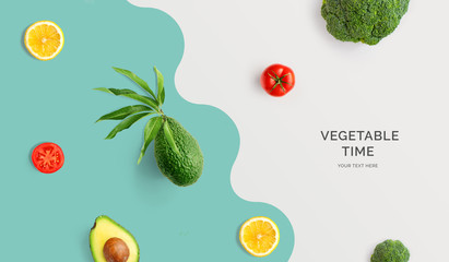 Creative layout made of avocado, tomato, lemon and broccoli. Flat lay. Food concept. Macro concept.