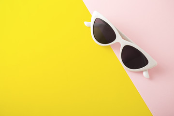 Sunglasses on yellow background