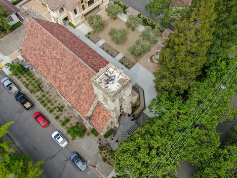 Aerial view of St. Helena Roman Catholic Church, historic church building in St. Helena, Napa Valley, California, USA. Built from 1889 to 1890, the church was constructed with stone, a common building
