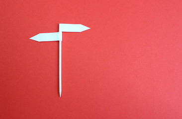 Two side arrow sign background made of paper