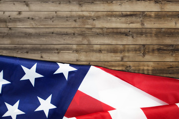 rippled usa flag for forth of july on wooden background fro american independence day