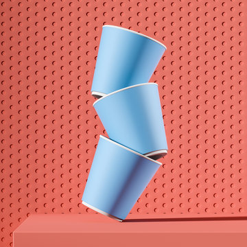 Stack of blue paper cups falling on pink table