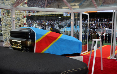 The casket with the remains of Etienne Tshisekedi, former Congolese opposition figurehead who died in Belgium two years ago, is seen on a podium during a mourning ceremony at the Martyrs of Pentecost Stadium in Kinshasa