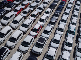 New cars parking lot, aerial view, sunny day