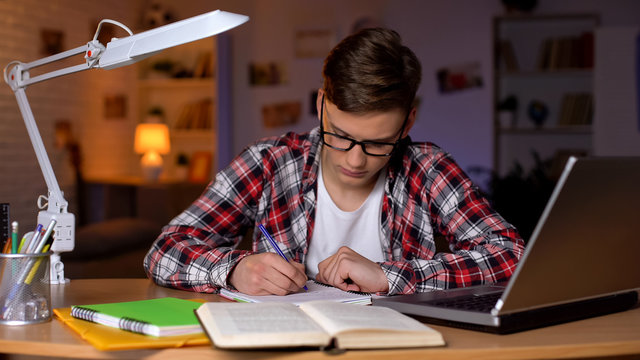 Exhausted sleepy student preparing for lectures suffering lack of energy college