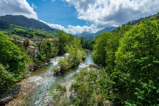View from Cangas de Onis along the river Sella towards the Nationalpark Picos de Europa in Asturias, Spain