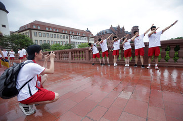 Newly recruited fresh graduates pose for a photo at Huawei Songshan Lake New Campus in Dongguan