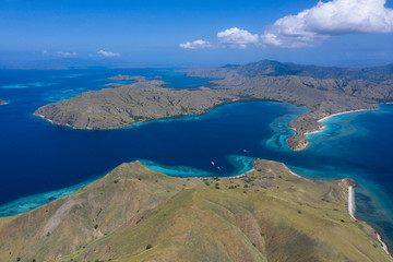 Wall Mural - The beautiful islands within Komodo National Park, Indonesia, are fringed by healthy coral reefs. This tropical area is known for both its marine biodiversity as well as its infamous dragons.