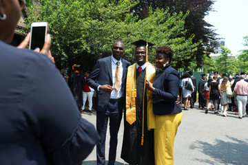 Benjamin Philip, 23, a graduate in engineering from The City College of New York poses for photos with his family at his commencement ceremony in Manhattan