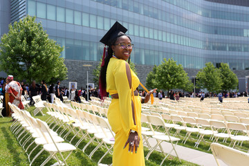 Alicia Davis, 22, a graduate in pyschology from The City College of New York poses for photos at her commencement ceremony in Manhattan