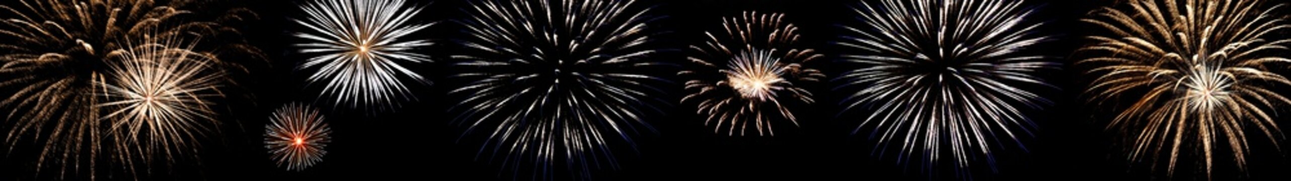 set of multi-colored fireworks with blue and red sparks on an isolated black background for the design of the holidays; the new year; as well as the independence day on July 4