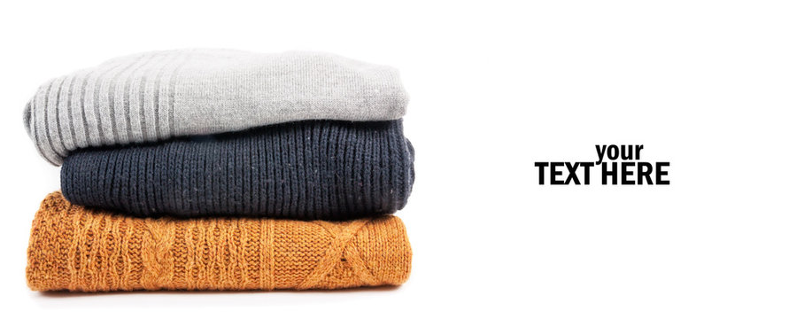 Sweaters in the stack on the white