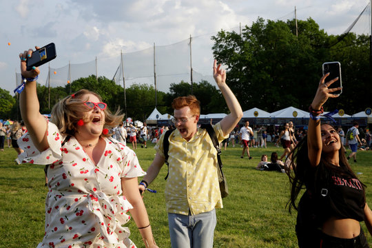 Attendees dance to the singer MO during the Governors Ball Music Festival on Randall's Island Park in New York
