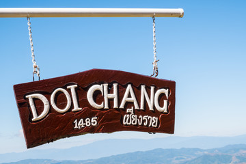 The wooden sign pole on the view point of Doi Chang village tell the high altitude of 1,485 metres above sea level. Wall mural