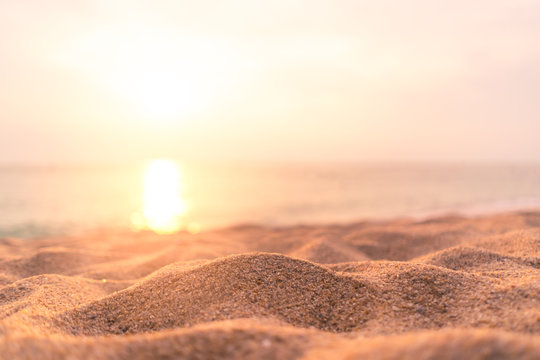Copy space of soft sand sea and blur tropical beach with sunset sky and cloud abstract background.
