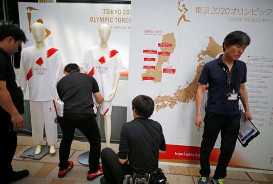 Uniforms for torchbearers of the Tokyo 2020 Olympic Games, and route maps of the torch relay are displayed at a Torch Relay event to mark the 300-day milestone to the starting date of the torch relay, in Tokyo