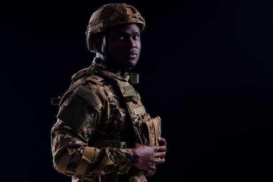 military army african male camouflage suit sorrow black background studio