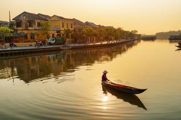 Gorgeous view of Vietnamese woman on boat at sunrise, Hoian