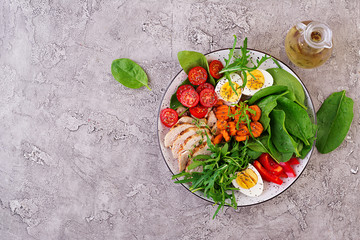 Plate with a keto diet food. Cherry tomatoes, chicken breast, eggs, carrot, salad with arugula  and spinach. Keto lunch. Top view Fototapete