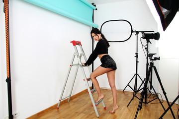 beautiful latin girl in photo studio