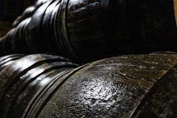 old wooden barrels for whiskey or wine