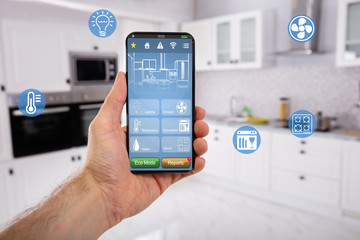 Hand Holding Mobile With Smart Home Control Icon Feature