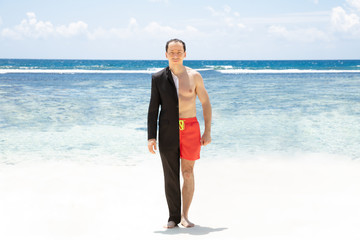 Man In Formalwear And Shorts Standing At Beach