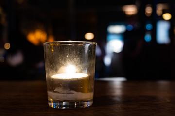 Candle in an irish pub