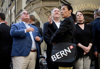 U.S. Ambassador Edward McMullen, U.S. Secretary of State Mike Pompeo, tour guide Denise O'Gorman and Susan Pompeo face the clock tower (Zytglogge) during a visit in Bern