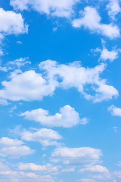 Beautyful blue sky with white clouds -  vertical background