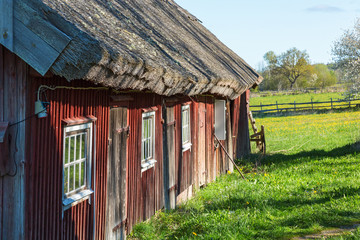 Wall Mural - Old weathered barn with thatched roof on a farm