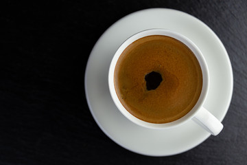 View from above of a delicious and tasty cup of freshly made coffee