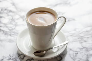 Front view of a delicious and tasty cup of freshly made coffee