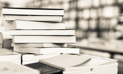 different books lying on table in library