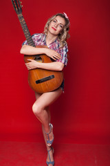 sexy girl posing with pin-up guitar