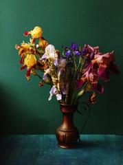 bouquet of irises in the antique vase