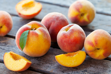 Fresh peaches, fruits on grey wooden background. Close up.