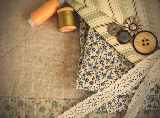 fabric, thread reels, buttons and lace tapes