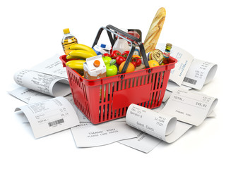 Grocery expenses budget  and consumerism. Shopping basket with foods on the pile of receipt isolated on white.
